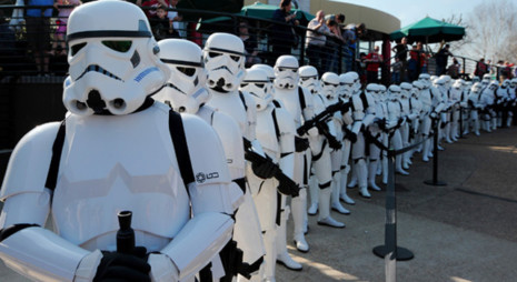 Star Wars Stormtroopers pose for photographers in a queue at Legoland in Windsor west of London on March 24, 2012, to mark the launch of the new Star Wars Miniland Experience. AFP PHOTO/CARL COURT