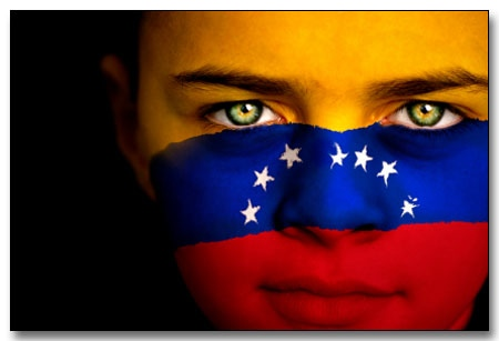 Portrait of a boy with the flag of Venezuela (Seven star version) painted on his face
